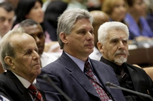 Miguel Diaz Canel sits between Ramiro Valdes (R) and outgoing National Assembly president Ricardo Alarcon (AP)