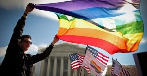 On March 27 in Washington, D.C., same-sex marriage supporters rally outside the Supreme Court as the Defense of Marriage Act case is heard.