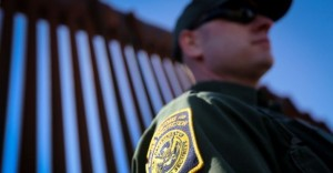 A U.S. Border Patrol agent stands at the border fence in Nogales, Ariz. (John Moore/Getty Images)