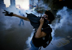 Opponents of the Maduro government battle police in Caracas on March 5. (Juan Barreto/AFP/Getty Images.)