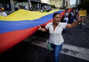 On April 25, student-led anti-government protests erupt again in Caracas. (Juan Barreto / AFP / Getty Images)